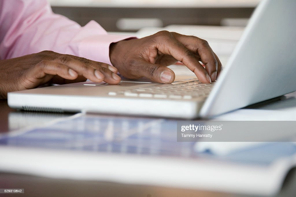 Businessman using laptop : Photo