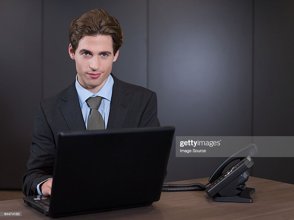 Businessman using laptop : Stock Photo