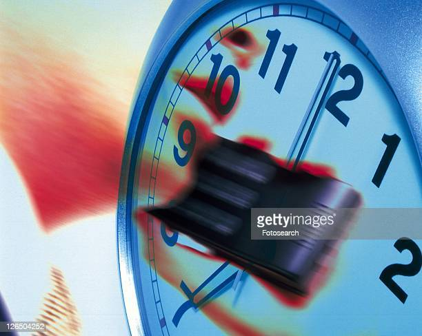 Businessman using mobile phone and image of clock, CG, composition, low angle view, close up