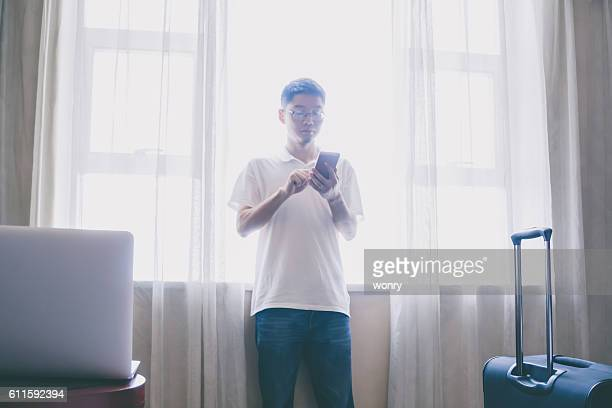 Businessman using mobile phone at hotel room