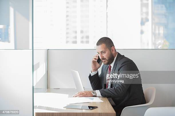 Businessman using mobile phone in office
