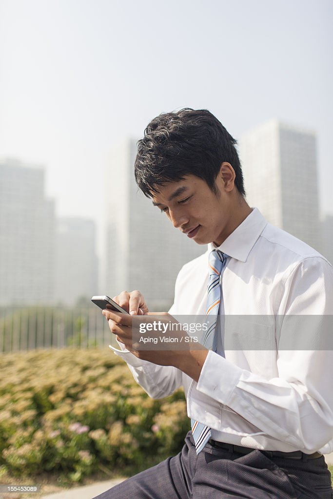 Businessman using mobile phone : Stock Photo