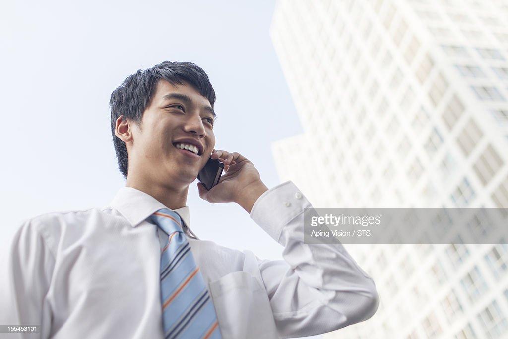 Businessman using mobile phone : Stock Photo