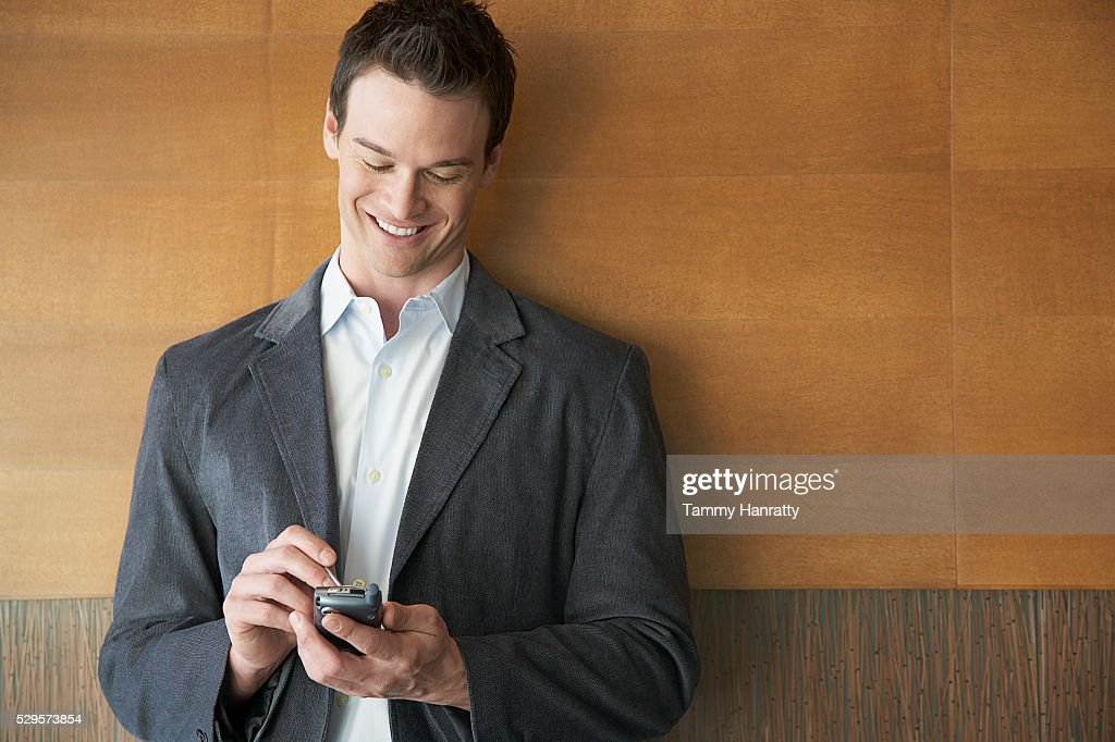 Businessman using PDA : Stockfoto
