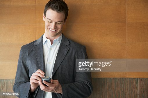Businessman using PDA : Bildbanksbilder
