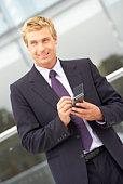 Businessman using PDA