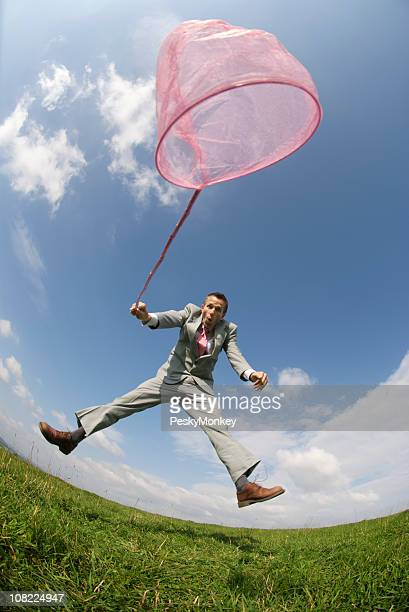 Businessman Using Pink Butterfly Net, Fisheye