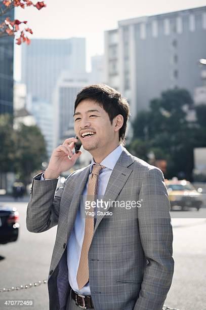 Businessman using Smartphone in city