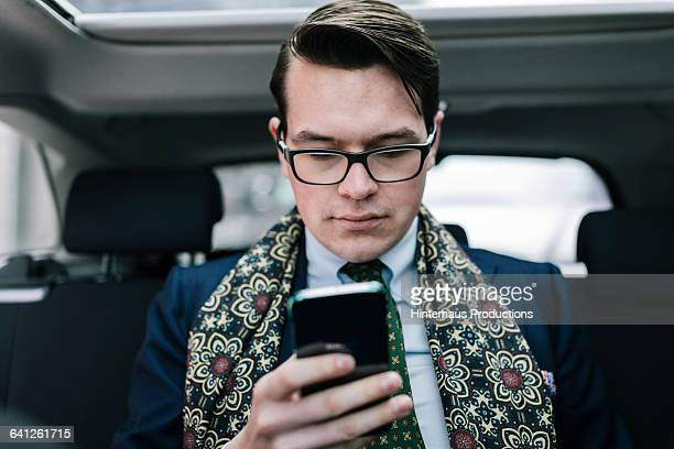 Businessman using Smartphone in Taxi