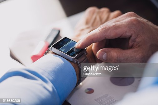 Businessman using smartwatch.