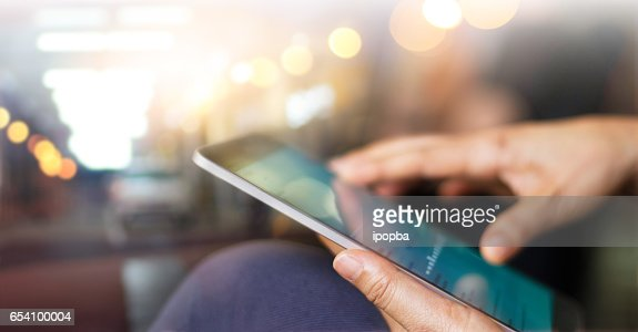 Businessman using tablet at night time : Stock Photo