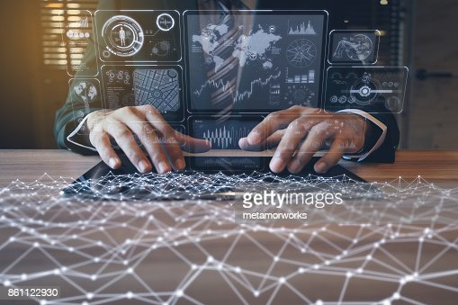 businessman using tablet PC and information communication technology concept. IoT(Internet of Things). GUI(graphical user interface). paperless office. : Stock Photo