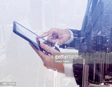 Businessman using tablet pc & double exposure