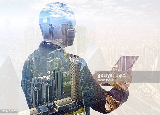 Businessman using tablet pc double exposure