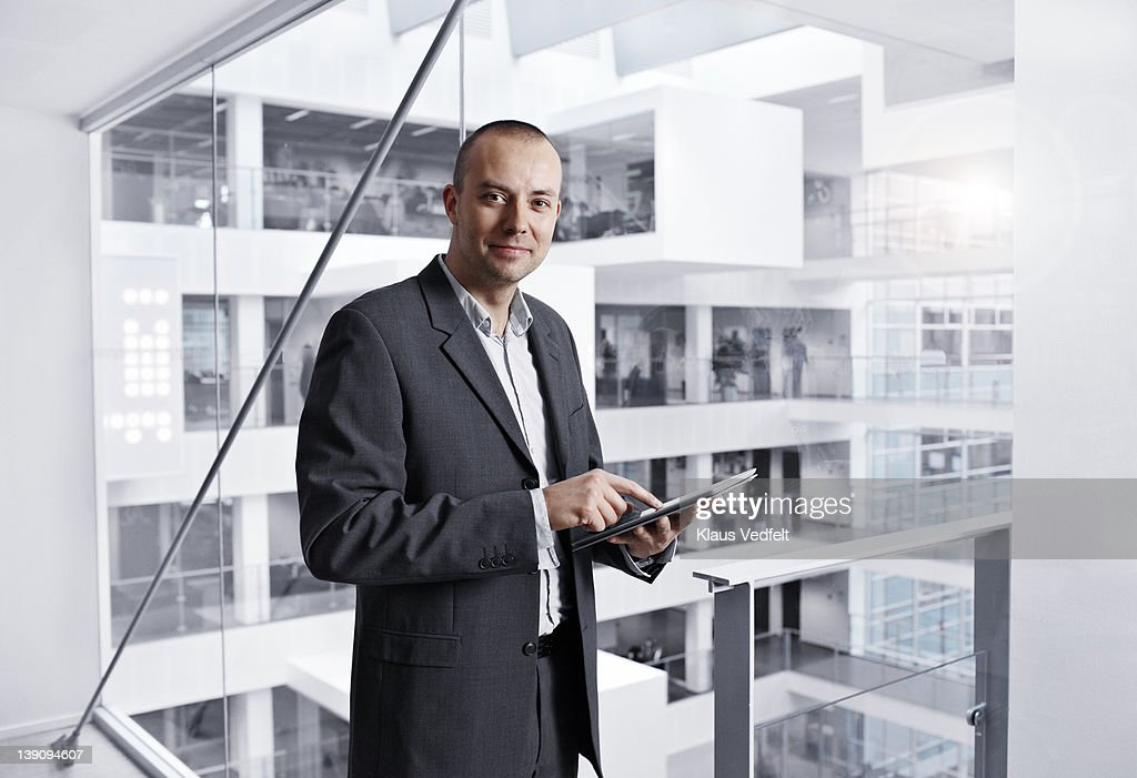Businessman using tablet : Stock Photo