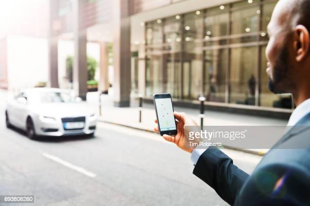 Businessman using taxi app