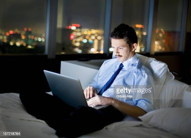 Businessman using the internet in hotel room