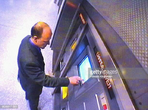 Businessman using ticket machine, elevated view (video still)