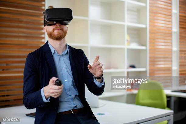 Businessman using virtual reality simulator headset
