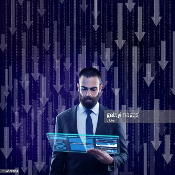 Businessman using virtual screen