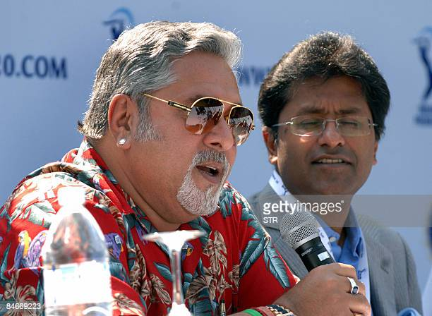 Businessman Vijay Mallya coowner of the Bangalore Royal Challengers speaks as Lalit Modi of the Indian Premier League looks on during the press...