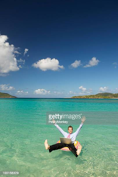 Businessman w Laptop Celebrates from Tropical Bay