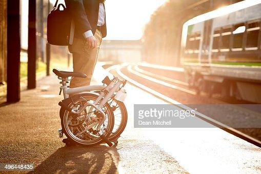 Businessman waiting at railway station platform
