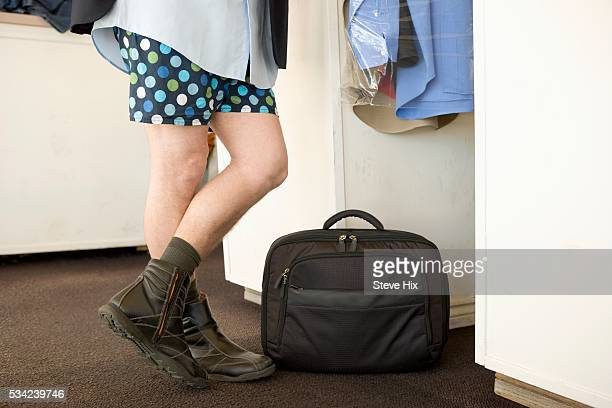 Businessman Waiting for His Pants at a Drycleaners