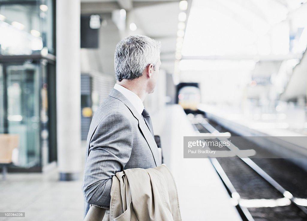 Businessman waiting for train on platform : Stock Photo