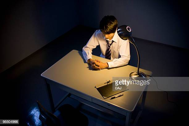 Businessman Waiting In Interrogation Room