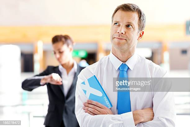 Businessman Waiting in Line at the Airport