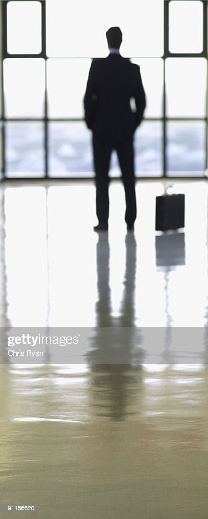 Businessman waiting in lobby : Stock Photo