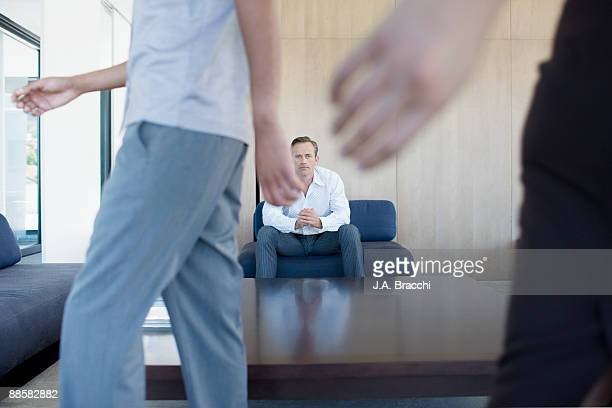 Businessman waiting in office reception area