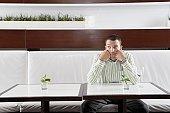 Businessman waiting in restaurant