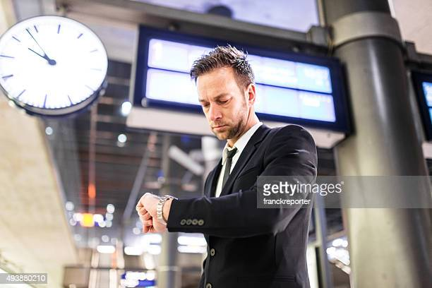 businessman waiting the train at the station