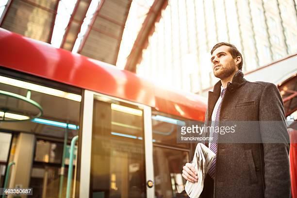 Businessman waiting the train on railway station
