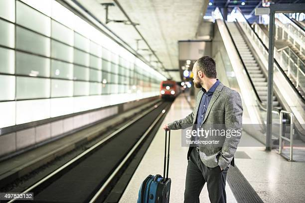 businessman waiting the train platform at the station
