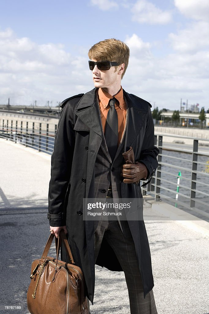A businessman walking across a bridge