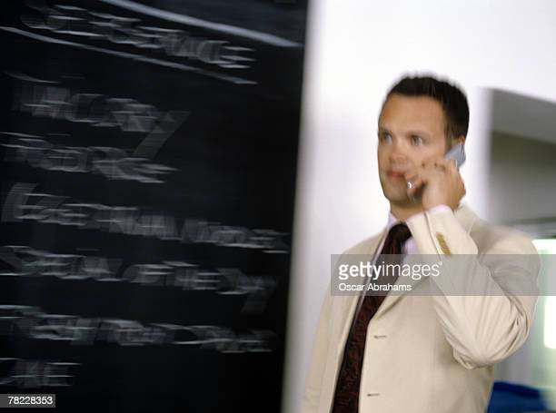 businessman walking by the slate in a restaurant with the daily menu