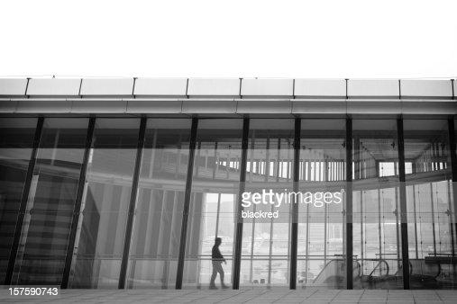 Businessman Walking by the Window