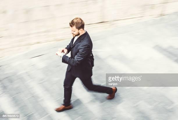 Businessman Walking, Checking Time