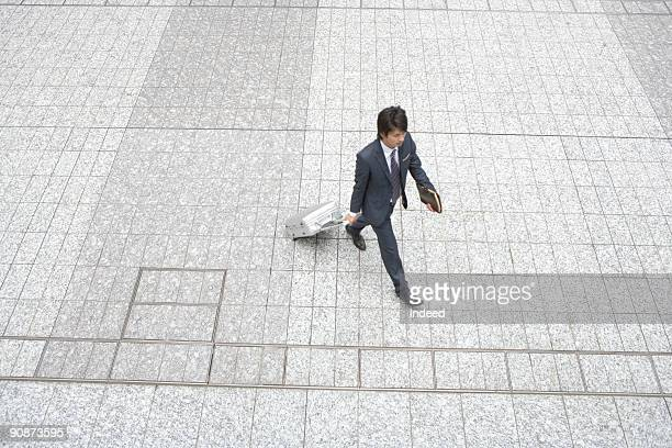 Businessman walking, high angle view