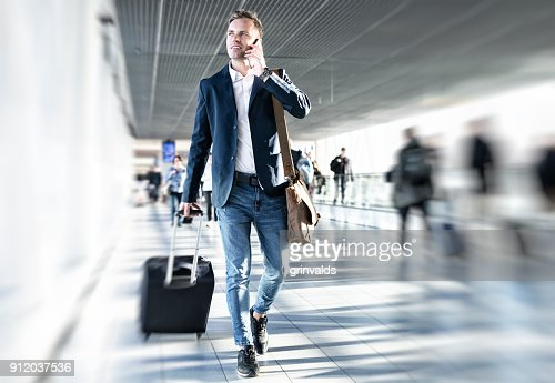Businessman walking in airport : Stock Photo
