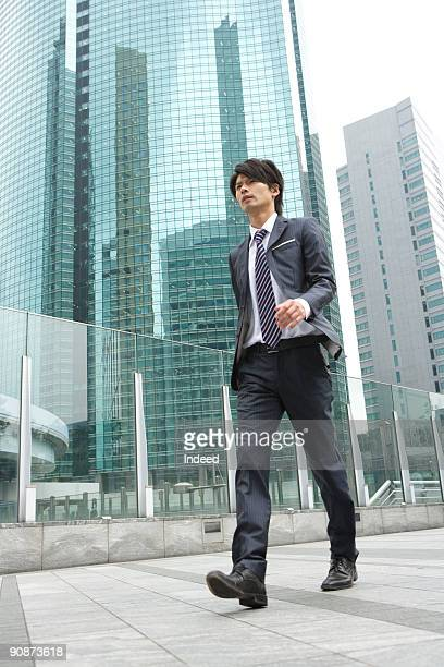 Businessman walking in city