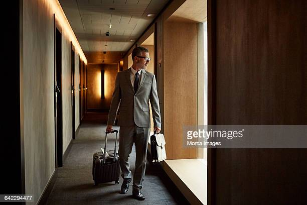 Businessman walking in corridor at hotel
