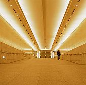 Businessman walking in corridor , rear view (blurred motion)
