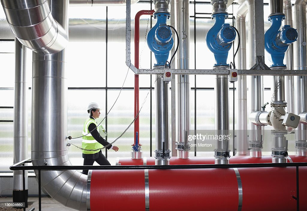 Businessman walking in factory : Stock Photo