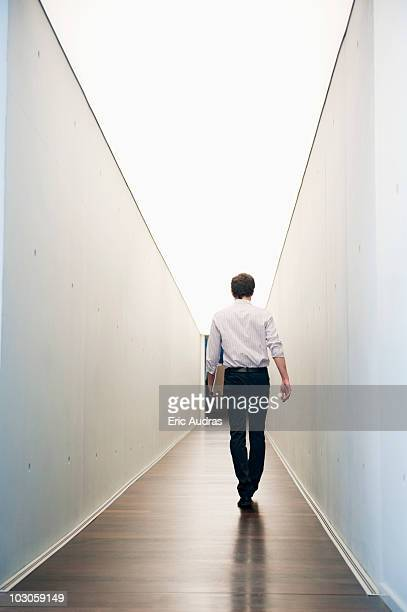 Businessman walking in the corridor of an office