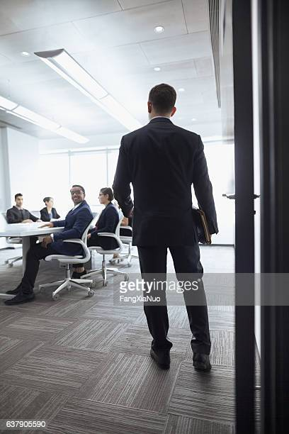 Businessman walking into a meeting room