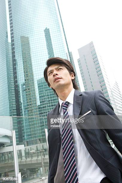 Businessman walking, looking up